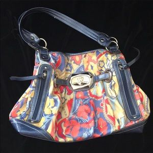 Kathy Van Zeeland purse Blue yellow & red motif.
